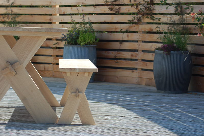 FSC European oak bench and table with locally sourced larch palisade fence.