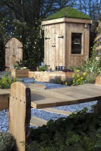 RHS Flower Show Cardiff. Small garden bench looking onto children's den.