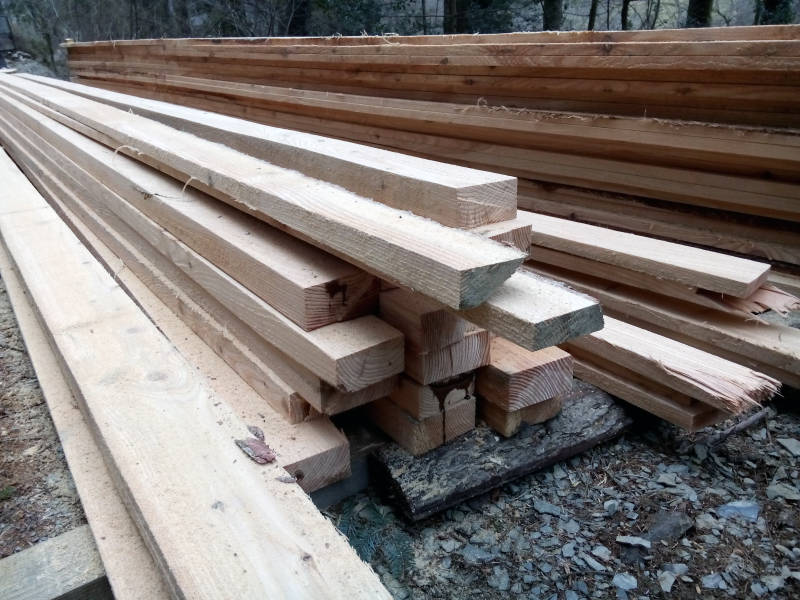 Stacked pile of swan timber from sustainably managed woodland.