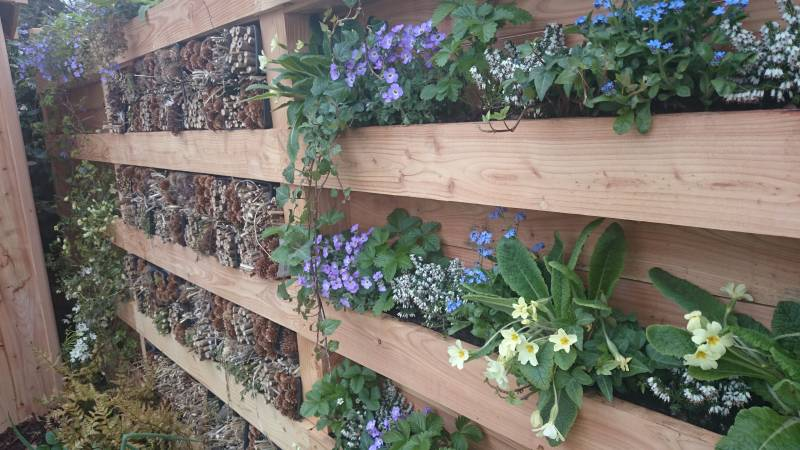 Wildlife Fence, larch and douglas fir palisades with wildlife planting and bug hotel.