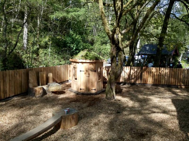 Long view of children's den taken from climbing frame.