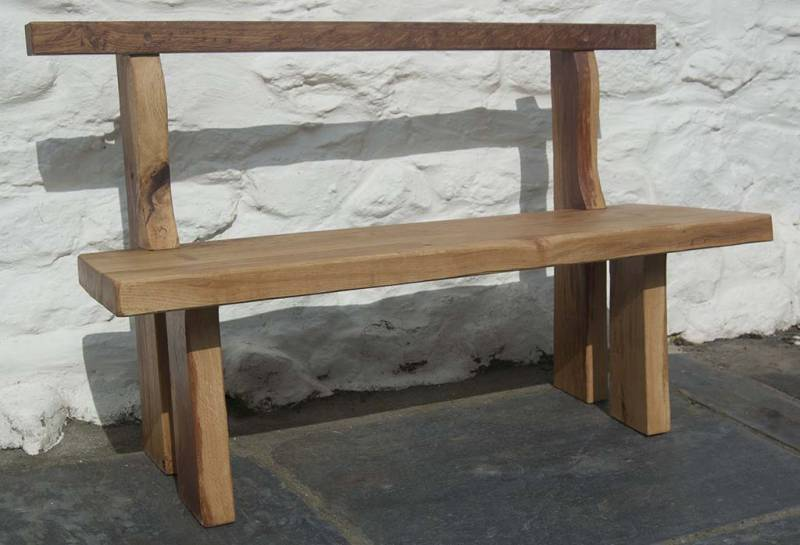 Oak bench against a white lime washed wall.
