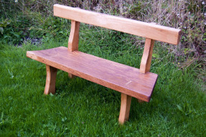 Showing the mortice joints on the legs of this rustic oak bench