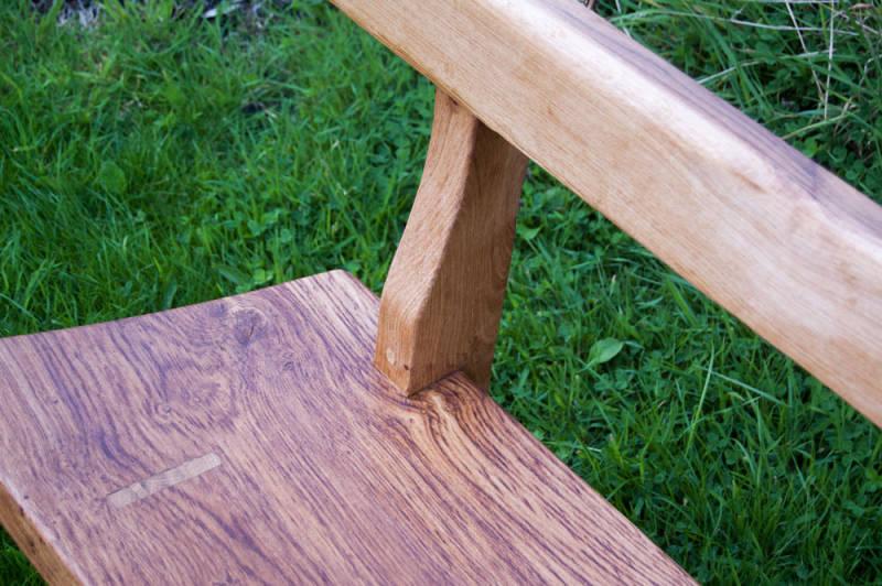 Side view of oak garden bench.